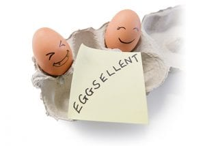 Smiling eggs with Post-It® note that reads
